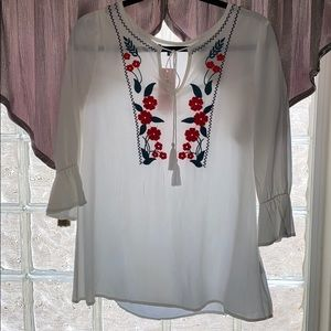 White shirt with embroidered red flowers